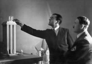 Dr. Albert Speer (left), Hitler's chief architect, presents his model of the German Pavilion, designed for the World's Fair in Paris in 1937. Date: 1937