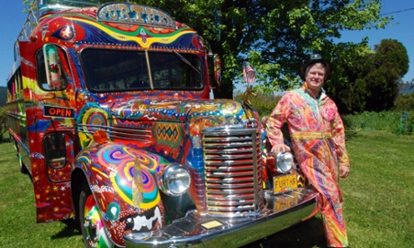In a May 14, 2014 photo, Zane Kesey poses with the latest version of the psychedelic bus Further in Pleasant Hill, Ore. Kesey is raising money on Kickstarter to put the bus on the road to commemorate the 50th anniversary of the 1964 LSD-fueled bus trip by his late father, author Ken Kesey, and his pals, the Merry Pranksters. (AP Photo/Jeff Barnard)