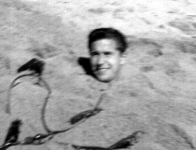 Greg 1962 burried in sand