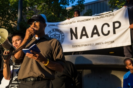 Eric Richardson, president of the Eugene NAACP, gives his speech about Trayvon Martin and the political issues that are present in the country. (Ryan Kang/Emerald)