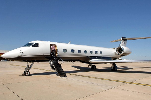 Picture taken 29 May 2007 shows Sir Philip Green's private jet put at Gerry and Kate McCann's disposal after hearing about Madeleine's abduction, at Faro airport in Portugal. Mccann couple will fly for Rome today to prepare a meeting with Pope Benedict XVI on 30 May. Madeleine, four-year old, was abducted 03 May 2007 as she was sleeping with her brother and sister in a hotel apartment at the Ocean Club Resort, while her parents were dining at a nearby restaurant. AFP PHOTO/Steve Parsons (Photo credit should read Steve Parsons/AFP/Getty Images)