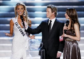 "Hosts Billy Bush, center, and Nadine Velazquez, right, listen as Miss California Carrie Prejean, left answers a question from judge Perez Hilton, unseen, about legalizing same-sex marriage during the Miss USA Pageant, Sunday April 19, 2009 in Las Vegas. ""We live in a land where you can choose same-sex marriage or opposite marriage,"" Prejean said. ""And you know what, I think in my country, in my family, I think that I believe that a marriage should be between a man and a woman. No offense to anybody out there, but that's how I was raised."" (AP Photo/Eric Jamison) Original Filename: Miss_USA_NVEJ114.jpg"