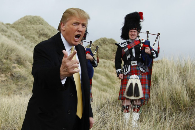U.S. property mogul Donald Trump gestures during a media event on the sand dunes of the Menie estate, the site for Trump's proposed golf resort, near Aberdeen, north east Scotland May 27, 2010. REUTERS/David Moir (BRITAIN POLITICS - Tags: SPORT GOLF BUSINESS) - RTR2EFTU