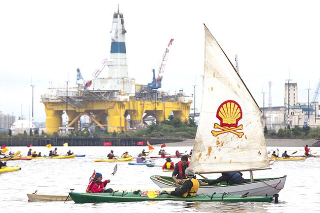 SEATTLE, WA - MAY 16: ShellNo flotilla participants float near the Polar Pioneer oil drilling rig during demonstrations against Royal Dutch Shell on May 16, 2015 in Seattle, Washington. On Saturday demonstrators began three days of protests both on land and on Puget Sound over the presence of the first of two Royal Dutch Shell oil rigs in the Port of Seattle.   David Ryder/Getty Images/AFP == FOR NEWSPAPERS, INTERNET, TELCOS & TELEVISION USE ONLY ==