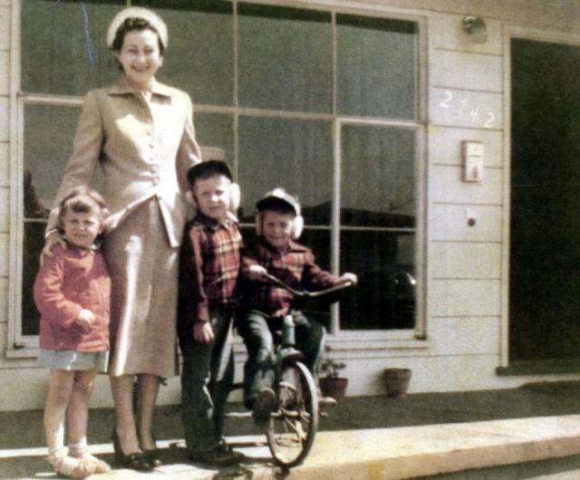 Prescos 1951 Christine, June Rice, Greg & Mark on porch