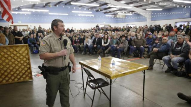 Harney County Sheriff David Ward listens to concerns during a community meeting at the Harney County fairgrounds Wednesday, Jan. 6, 2016, in Burns, Ore. (AP Photo/Rick Bowmer)